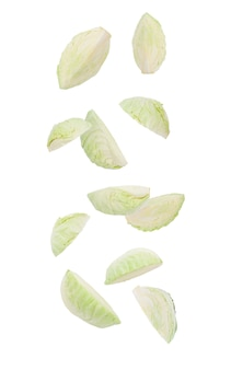 Cutted green cabbage falling isolated on white with clipping path.