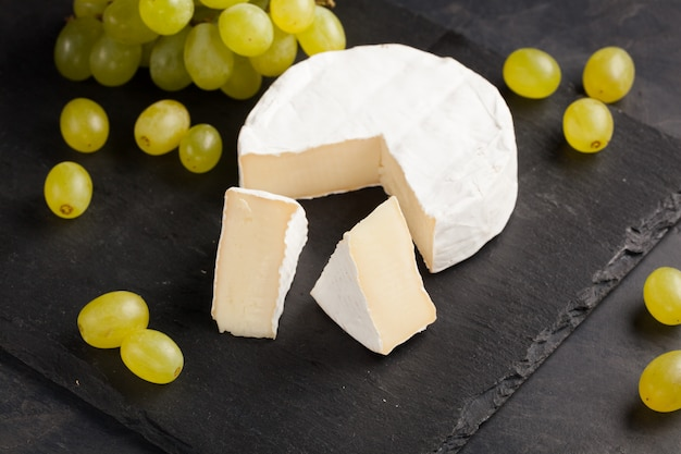 Cutting board of camembert cheese.