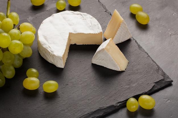 Cutting board of camembert cheese.