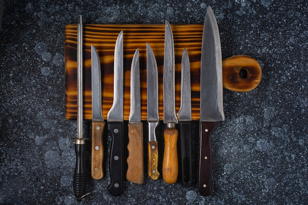 Cutting board and kitchen knives on the table.