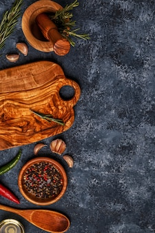Cutting board and spice for cooking.