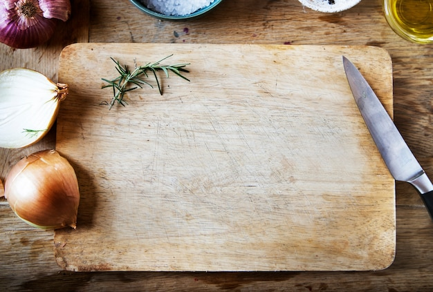 Cutting board and vegetables on a wooden table