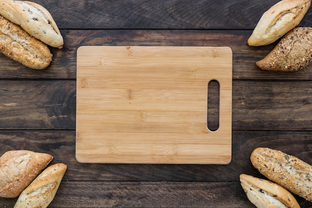 Cutting board with bread on table