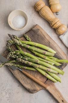 Cutting board with fresh bunch of asparagus