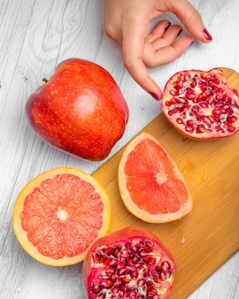 Cutting board with fresh red fruit