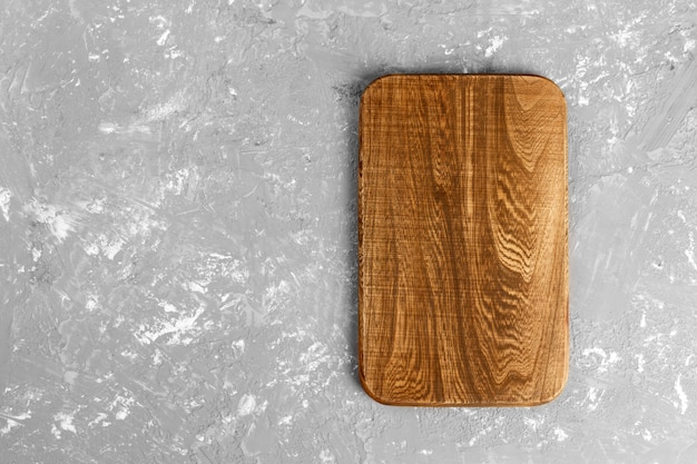 Cutting board on wooden  top view with copy space