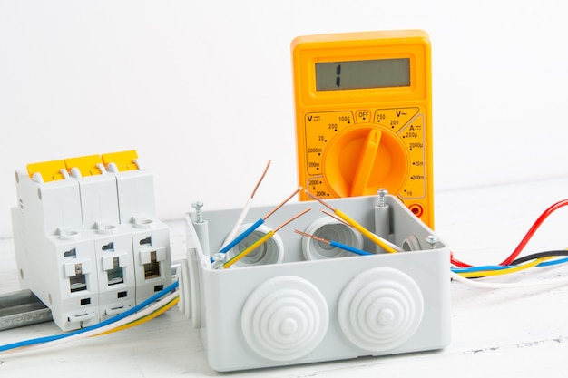 Cutting box, digital multimeter, circuit breakers and installation of power supply systems