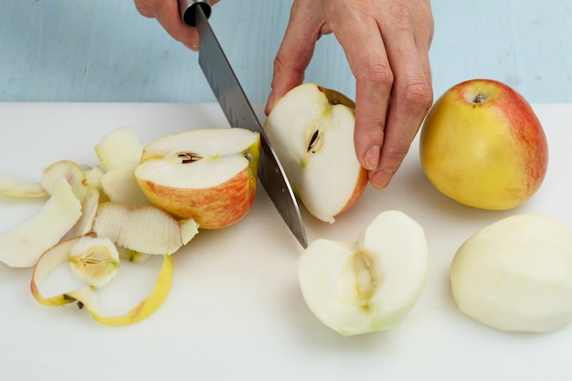 Cutting the fruit knife on a chopping board