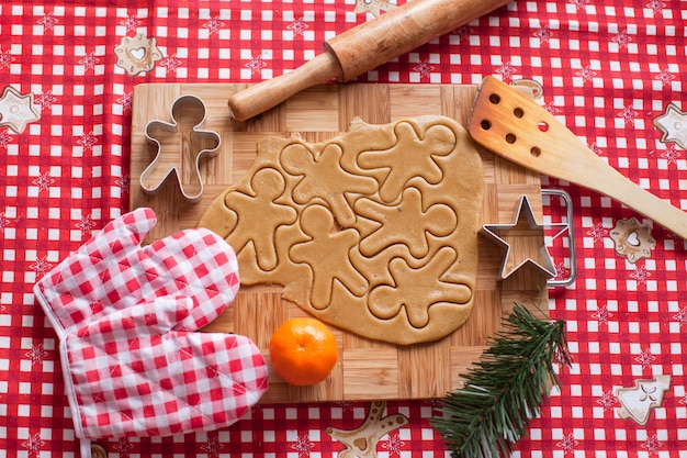 Cutting gingerbread cookie dough for christmas
