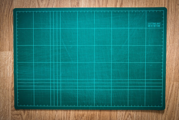Cutting mats on the wood background