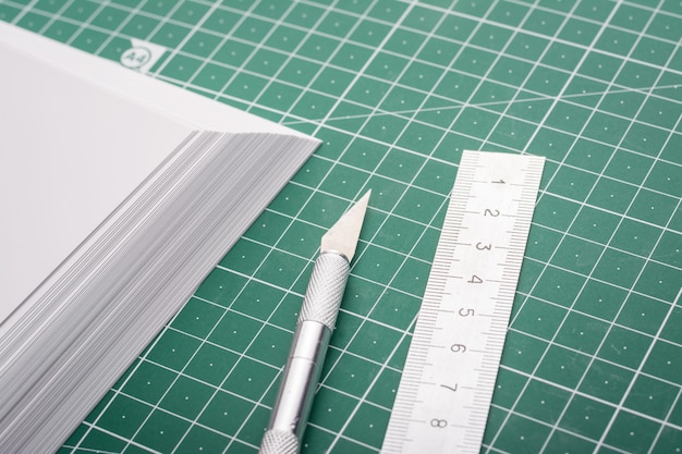 Cutting photo paper with scalpel and ruler on cutting mat