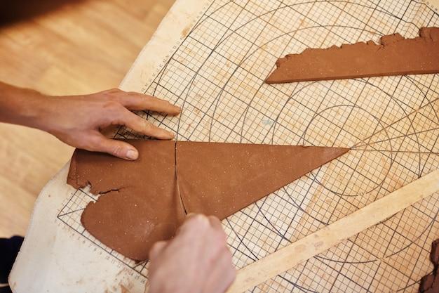 Cutting rolled clay