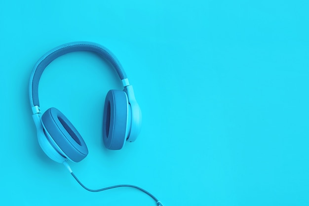 Cyan blue headphones with copyspace
