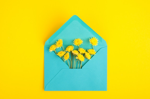 Cyan envelope and chrysanthemum flowers
