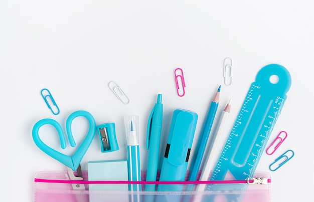 Cyan school supplies on white background. copy space, directly above