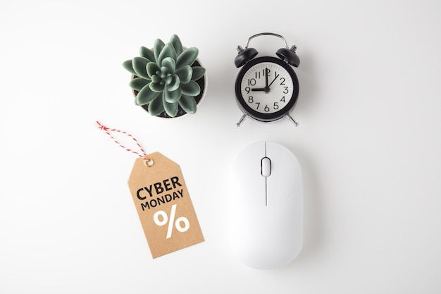 Cyber monday flat lay with mouse, clock, tag and plant