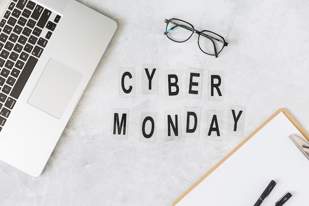 Cyber monday inscription on table with laptop