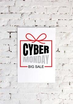 흰색 벽돌 벽 배경에 사이버 먼데이 레터링 광고. copyspace, 귀하의 광고에 대한 부정적인 공간. 검은 금요일, 판매, 금융, 광고, 돈, 금융, 구매 개념.
