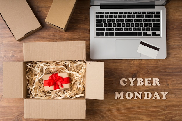 Cyber monday package next to laptop