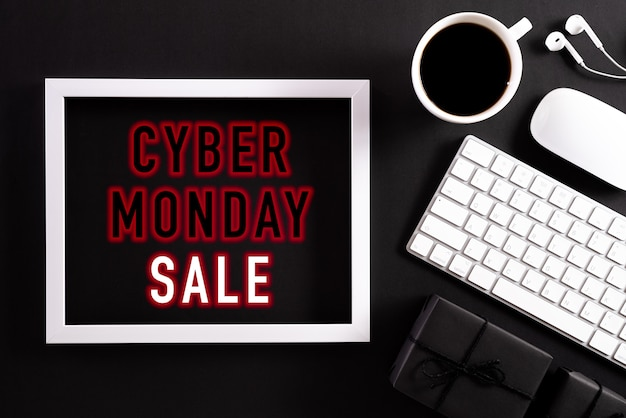 Cyber monday sale text frame on black with keyboard