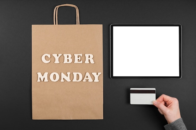 Cyber monday shopping bag with white tablet