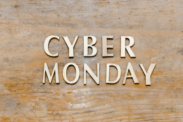 Cyber monday text on wooden background
