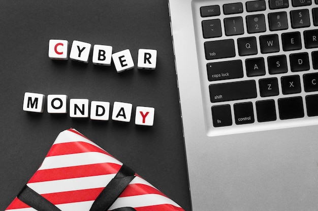 Cyber monday written with scrabble letters and laptop