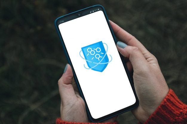 Cyber protection concept. virtual antivirus program shield icon in smartphone