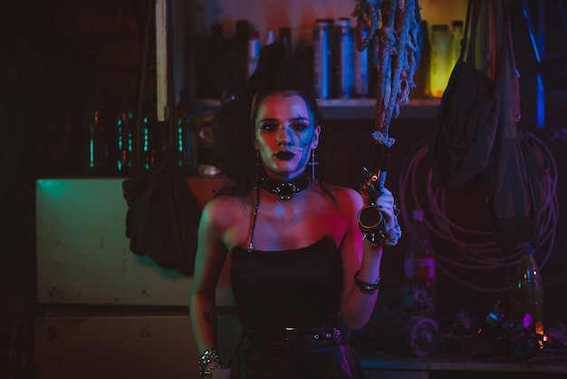 Cyberpunk cosplay. a girl with makeup and hair styling in a futuristic steampunk style with neon lighting. post-apocalyptic style
