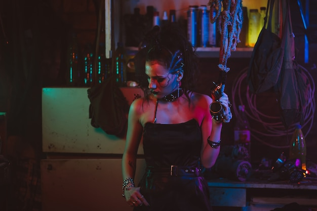 Cyberpunk cosplay. a girl with makeup and hair styling in a futuristic steampunk style