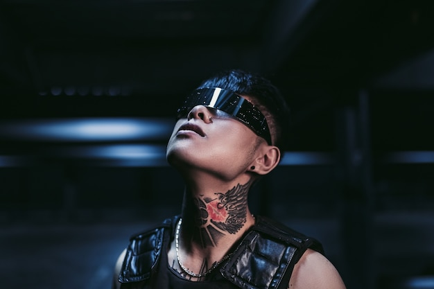 Cyberpunk style. tattooed guy in one city. cyberpunk glasses. fantasy.