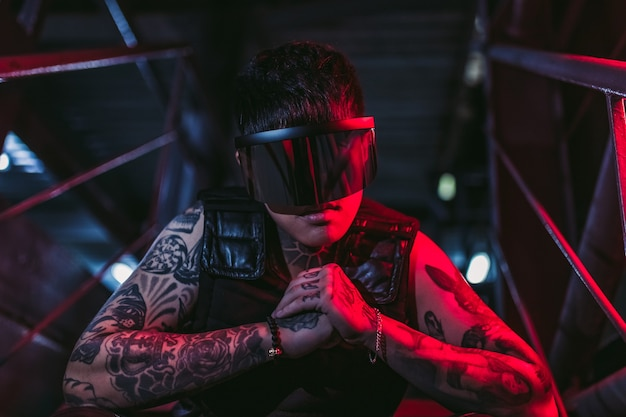 Cyberpunk style. tattooed guy in one city. cyberpunk glasses. fantasy.