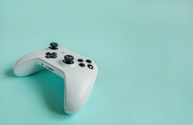 Cyberspace symbol. white joystick gamepad, game console isolated on pastel blue colourful trendy background. computer gaming competition videogame control confrontation concept.