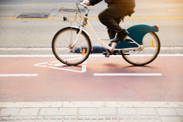Cycle lane with cyclist riding bicycle