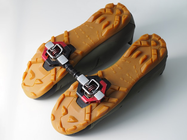 Cycling shoes with pedal, attached to the sole.