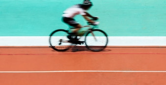 Cyclist biking at a stadium