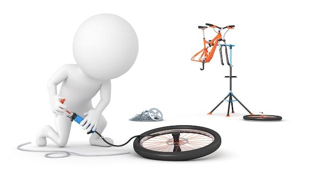 Велосипедист накачивает шину