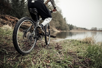 Cyclist riding bicycle near the lake