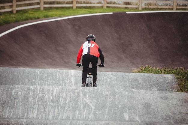 Cyclist riding bmx bike in skatepark