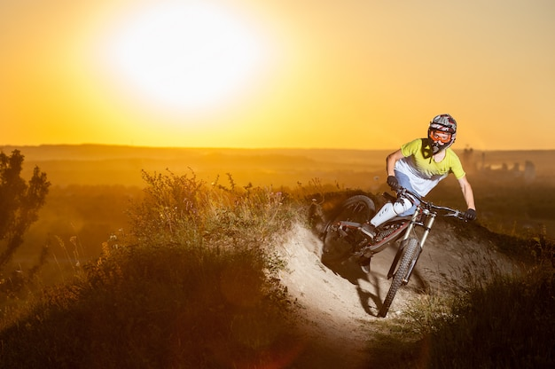 Cyclist riding downhill on mountain bike on the hill