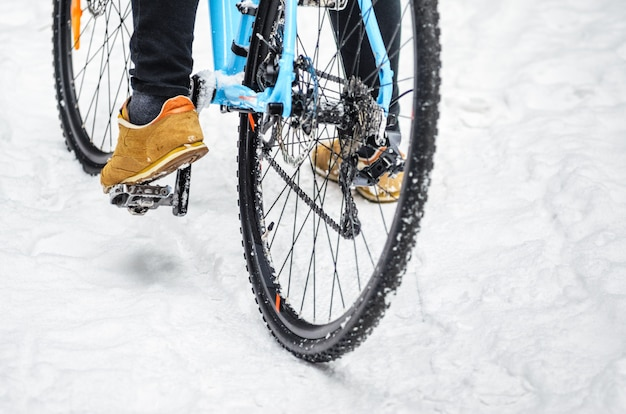 Cyclist in the snowy forest