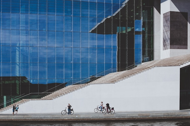 Cyclists in front of a huge stairway of a government building in berlin