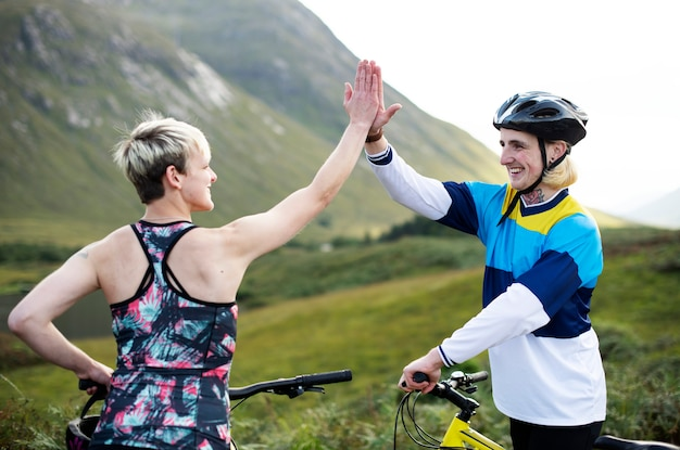 Cyclists giving each other a high five