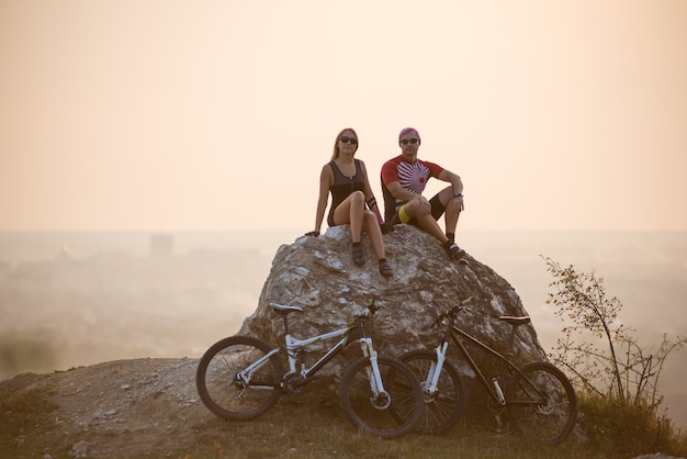 Cyclists on large stone