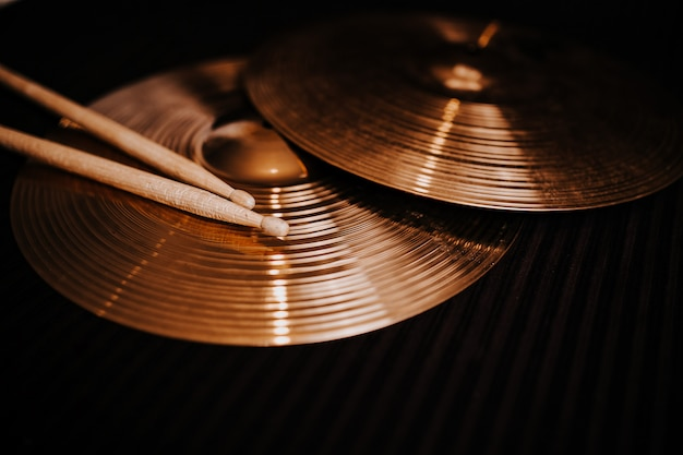 Cymbals on the dark background
