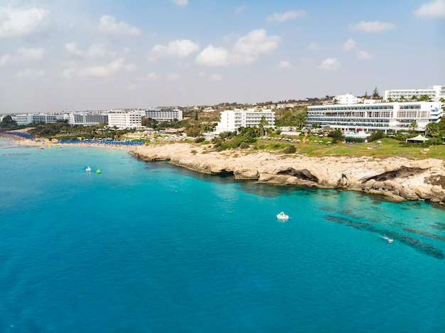 Cyprus beautiful coastline, mediterranean sea of turquoise color. houses on the mediterranean coast. tourist town with a beach. summer vacation at sea, cyprus, ayia napa.