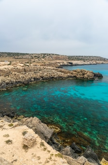 Cyprus cape cavo greco tourists arrived by car to the blue lagoon for swimming