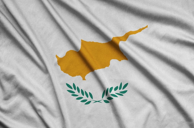 Cyprus flag is depicted on a sports cloth fabric with many folds.