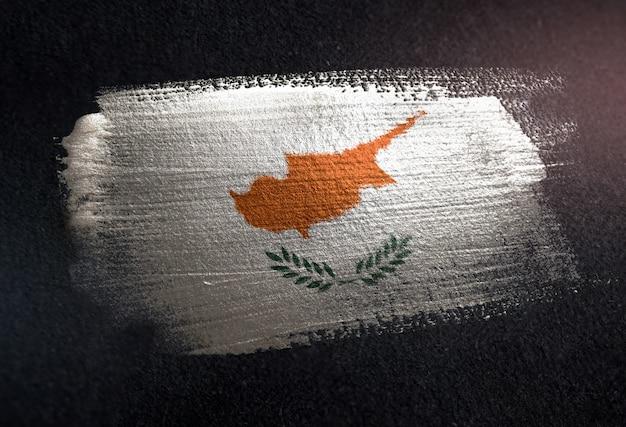 Cyprus flag made of metallic brush paint on grunge dark wall