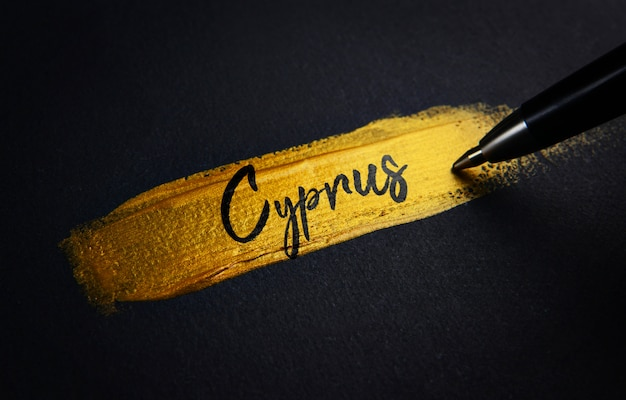 Cyprus handwriting text on golden paint brush stroke